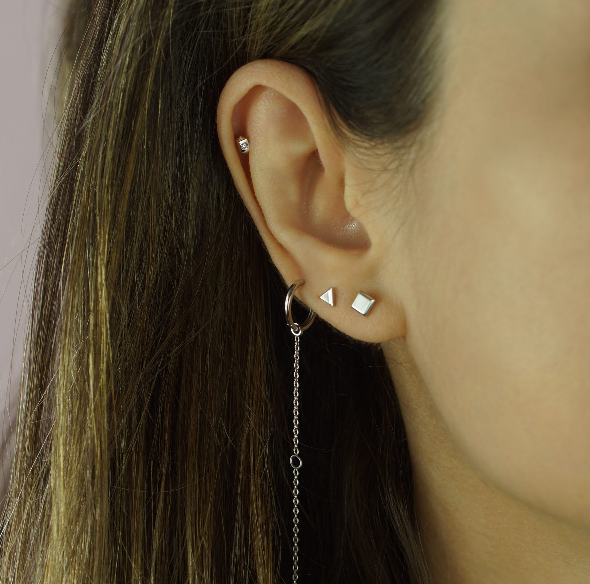 minimalist diamond studs stacked hoops on your helix and little clusters of studs on your lobes