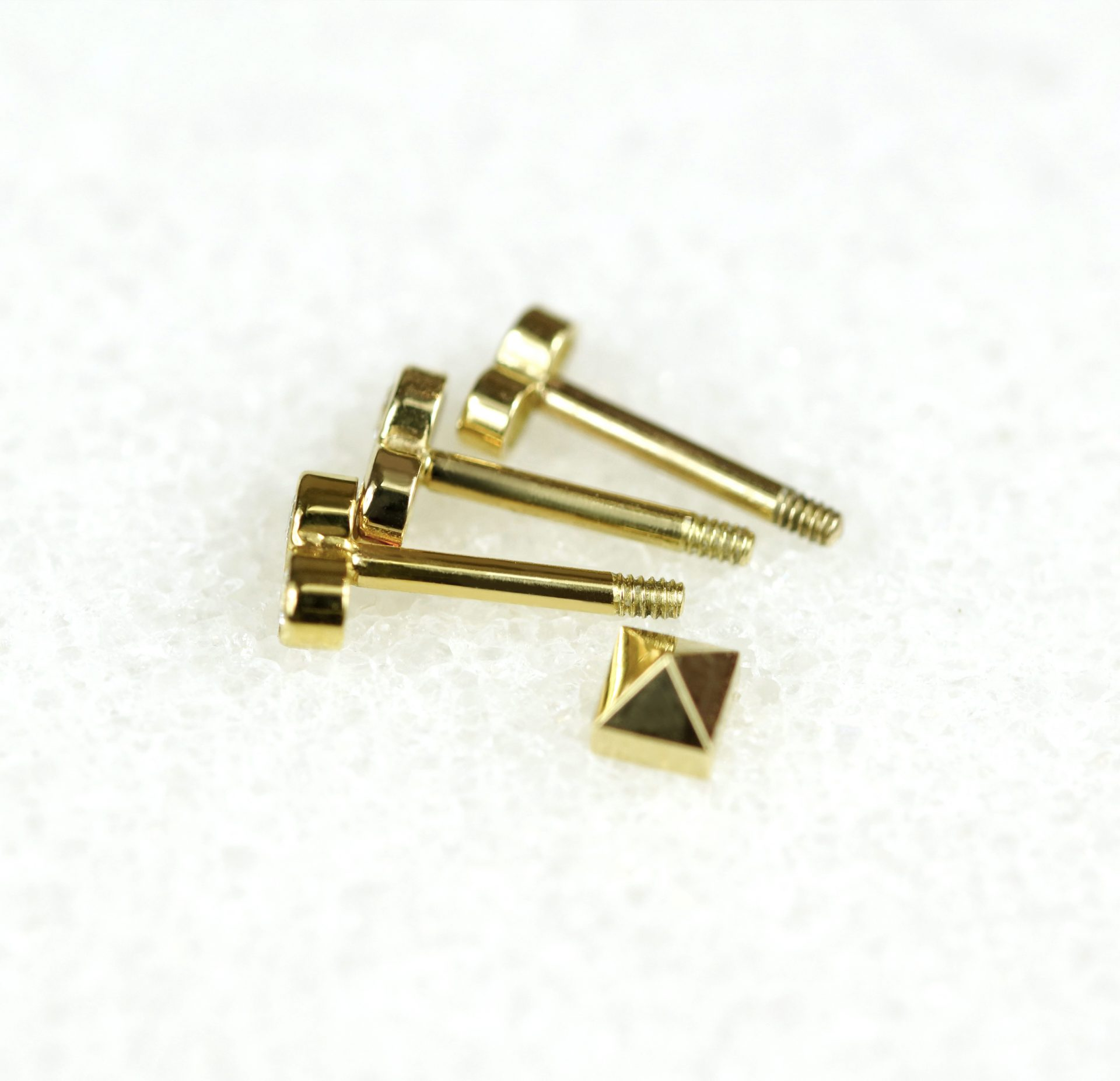 curated-ear-how-to-wear-piercing-diamond-piercing-studs-fasion-gold-buy-online-lena-cohen-uk