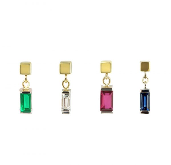 18k gold minimalist earring stud, with a baguette shaped emerald ruby diamond saphire