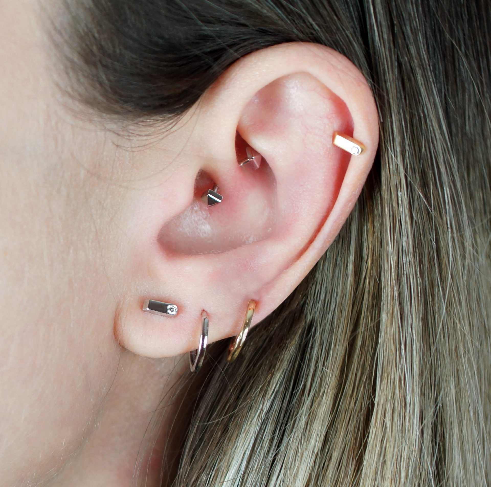 Daith piercings with fine jewelry are increasingly popular. Perfect for creative ear piercing combinations.