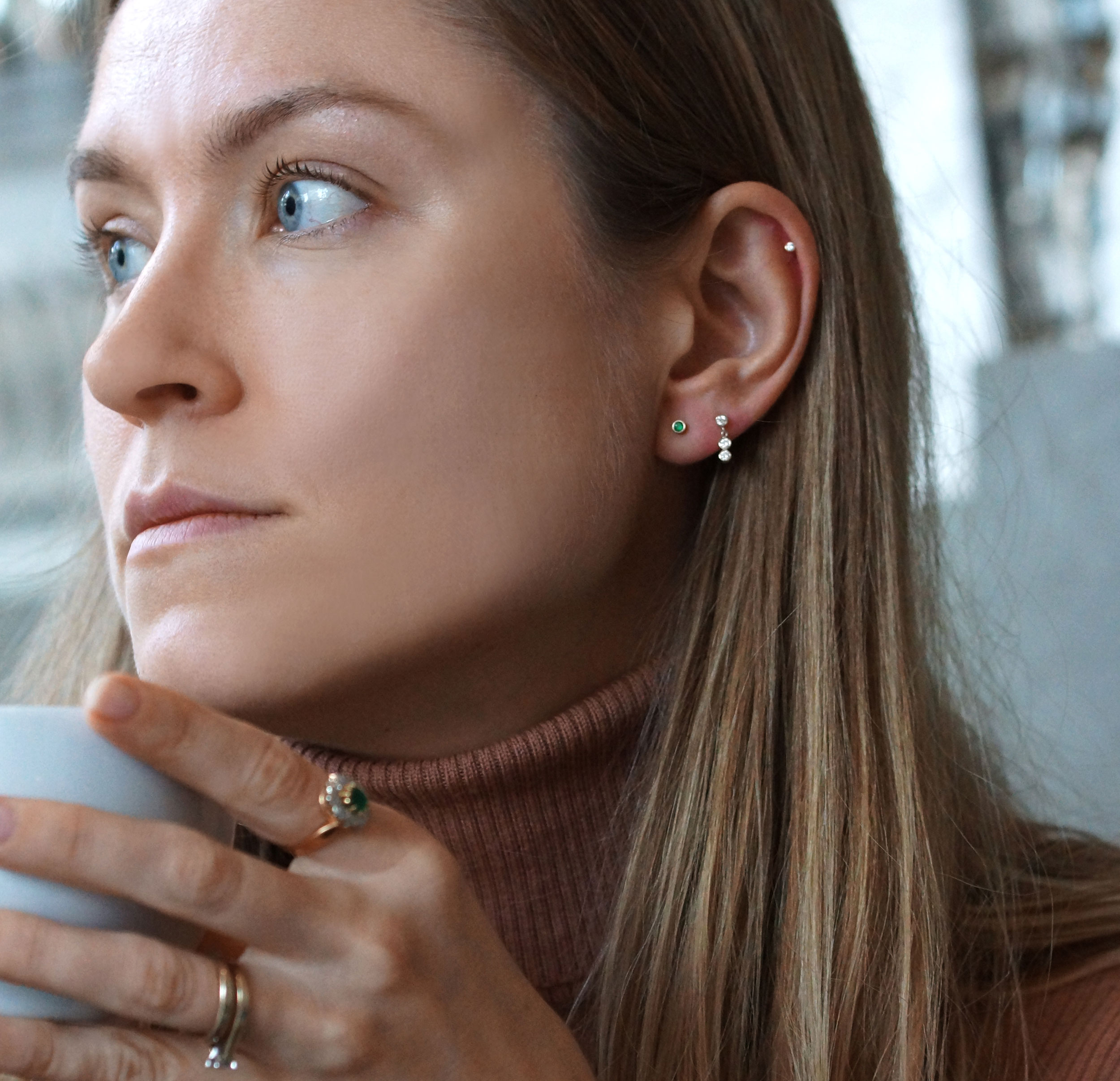 The threaded post fastens with our signature screw backs which are solid and have a good weight of 18k gold, it is created this way in order to give the perfect balance between the front and the back of the piercing earrings
