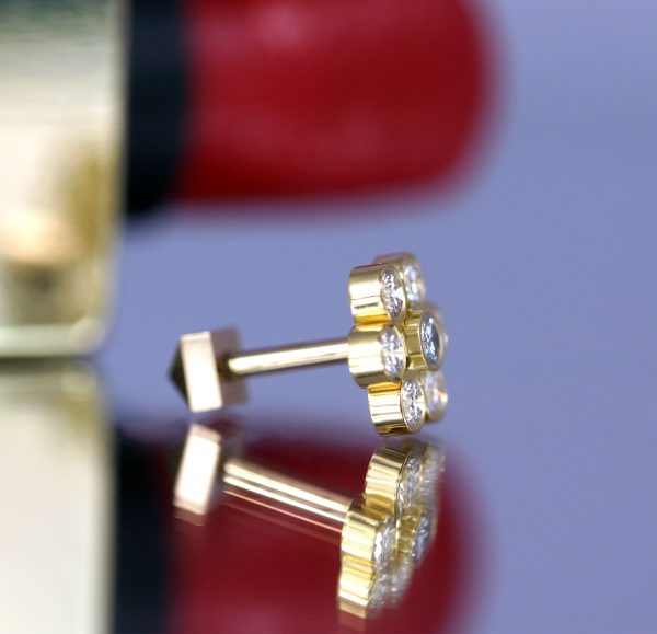 Made from solid yellow gold and diamonds, these round earrings offer an unparalleled look to your beautiful ears. They can be bought online from Lena Cohen.