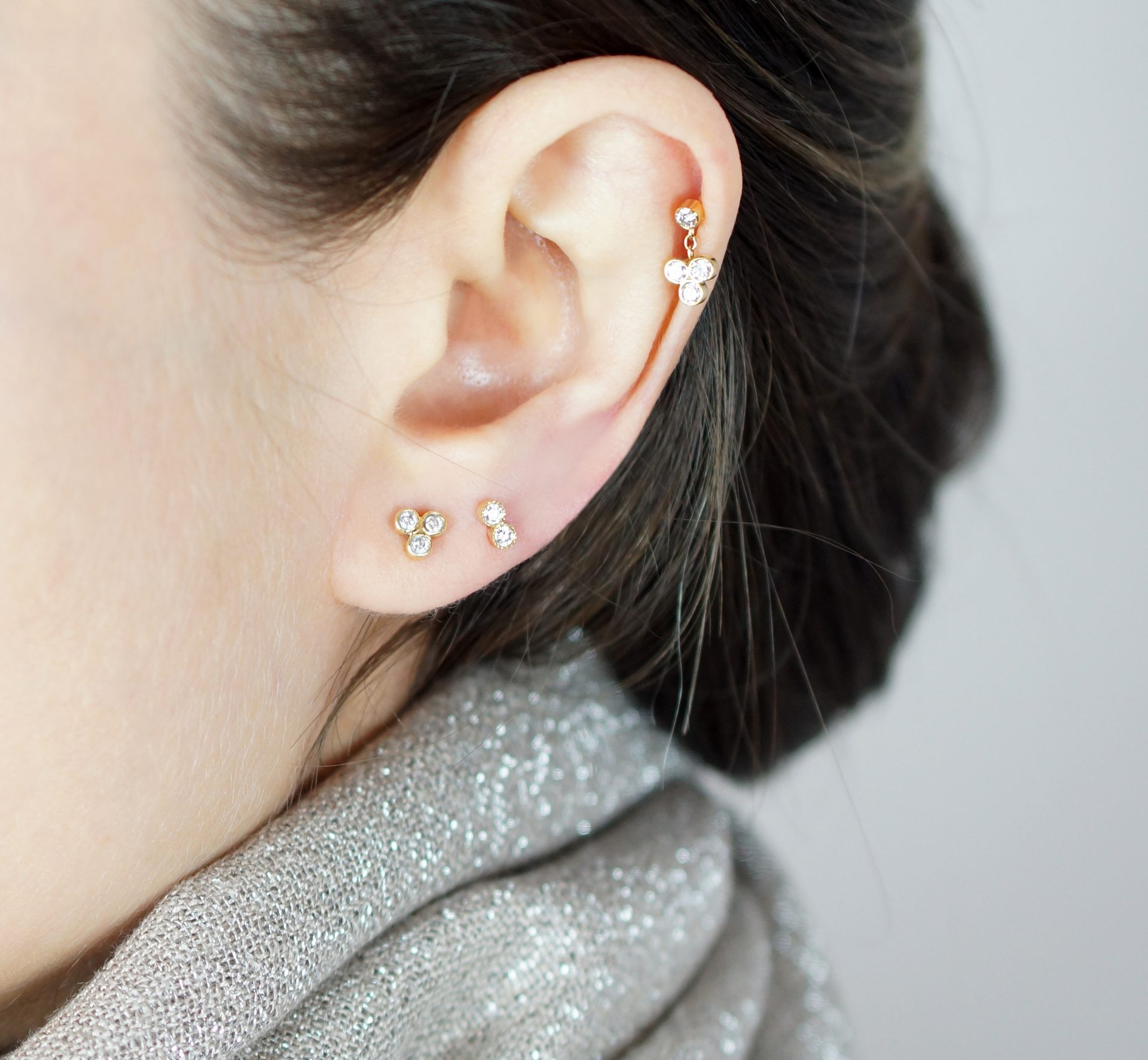 How best to layer your ear jewellery? It is just about how you like to combine your piercings and depends on the shape of your ear. What is the most popular ear piercing? Regarding cartilage piercings, helix and tragus are the most popular. You may simply go for multiple lobe piercings too; this is always an option.
