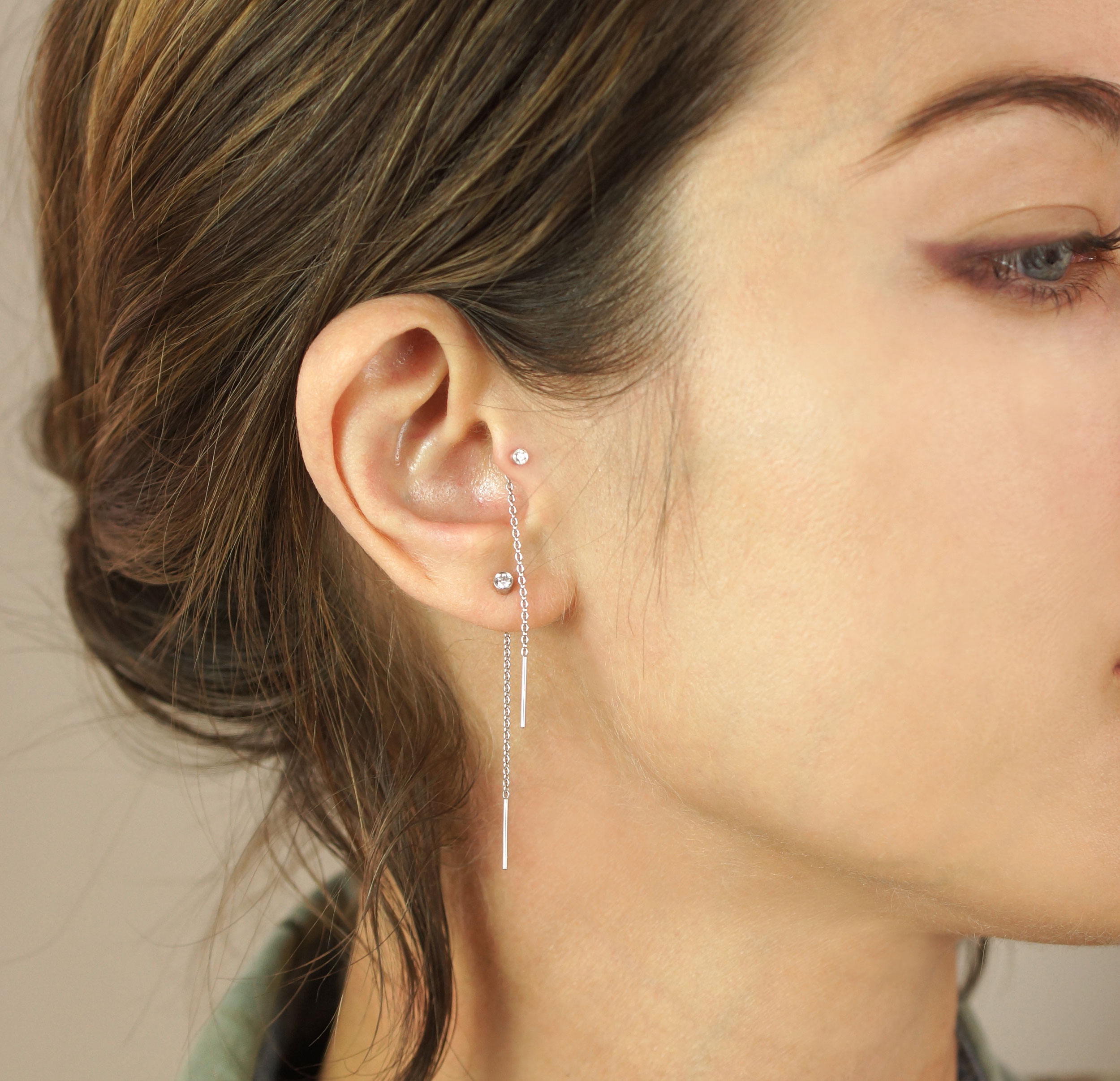824da1891 ... who sells tragus earrings made from precious metals and stones such as  diamonds, gold, rubies and emeralds. Wear a combination that seamlessly  syncs ...