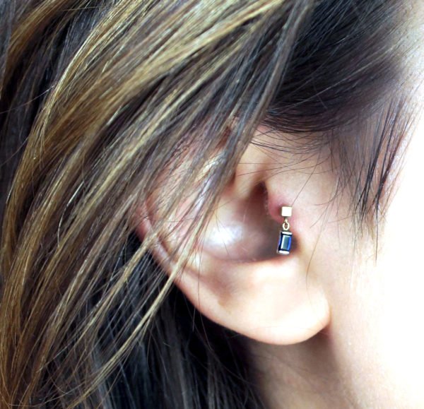 Genuine sapphire cartilage piercing earring handmade from 18k yellow and white gold, and polished to a mirror shine.