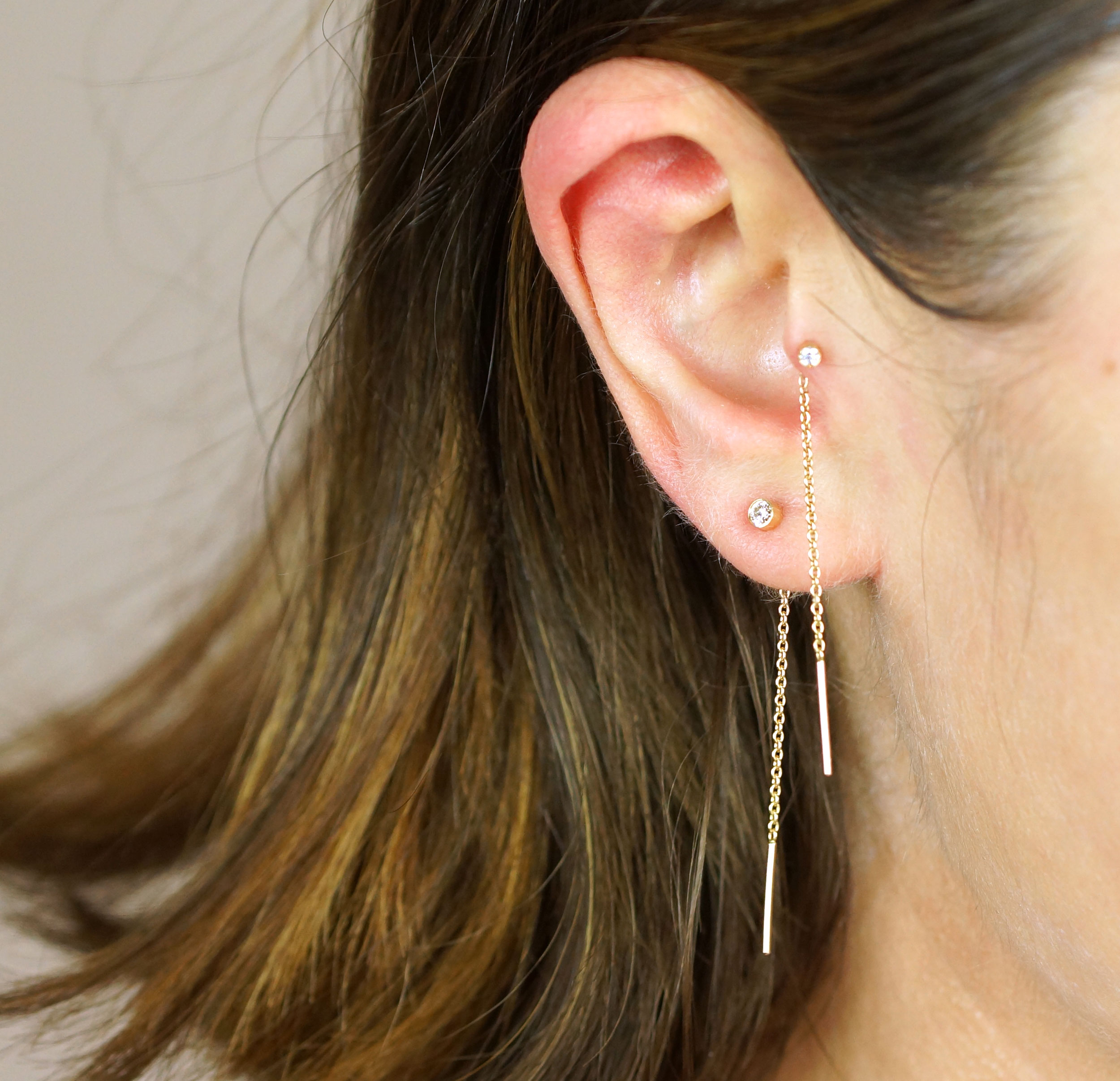 These sophisticated cartilage earrings feature glittering natural diamond in a delicate setting with stylish pyramid screw backs. These smart classic jewellery radiate sophisticated elegance and crisp shapes, and are a must-have item within any style preference.