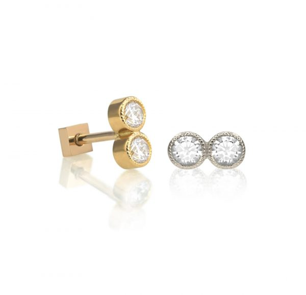 This stud features two natural white diamonds with a delicate milgrain edging adding a subtly vintage effect
