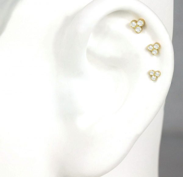 The perfect luxury ear piercing combinations of minimalist and classy diamond studs and hoops or huggies, and it's super customizable as Lena Cohen Jewellery provides build your own piercing service