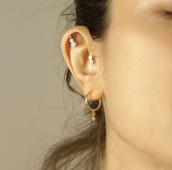 """Create your own """"curated ear"""" with this versatile diamond stud earring"""