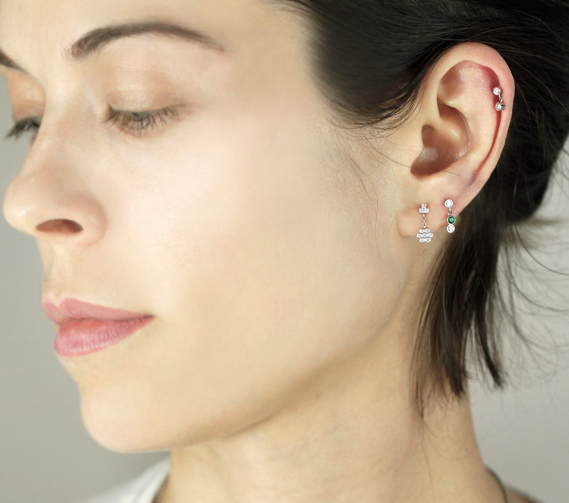 Diamond cartilage piercing earring handmade from 18k white gold, and polished to a mirror shine