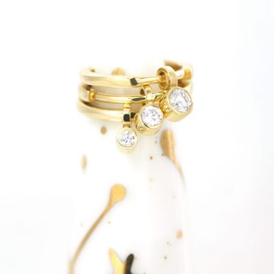 18k-solid-yellow-gold-huggie-hoop-single-diamond-charm-faced-to-the-front-to-show-it's-beauty-in-a-maximum-when-wearing-in-helix