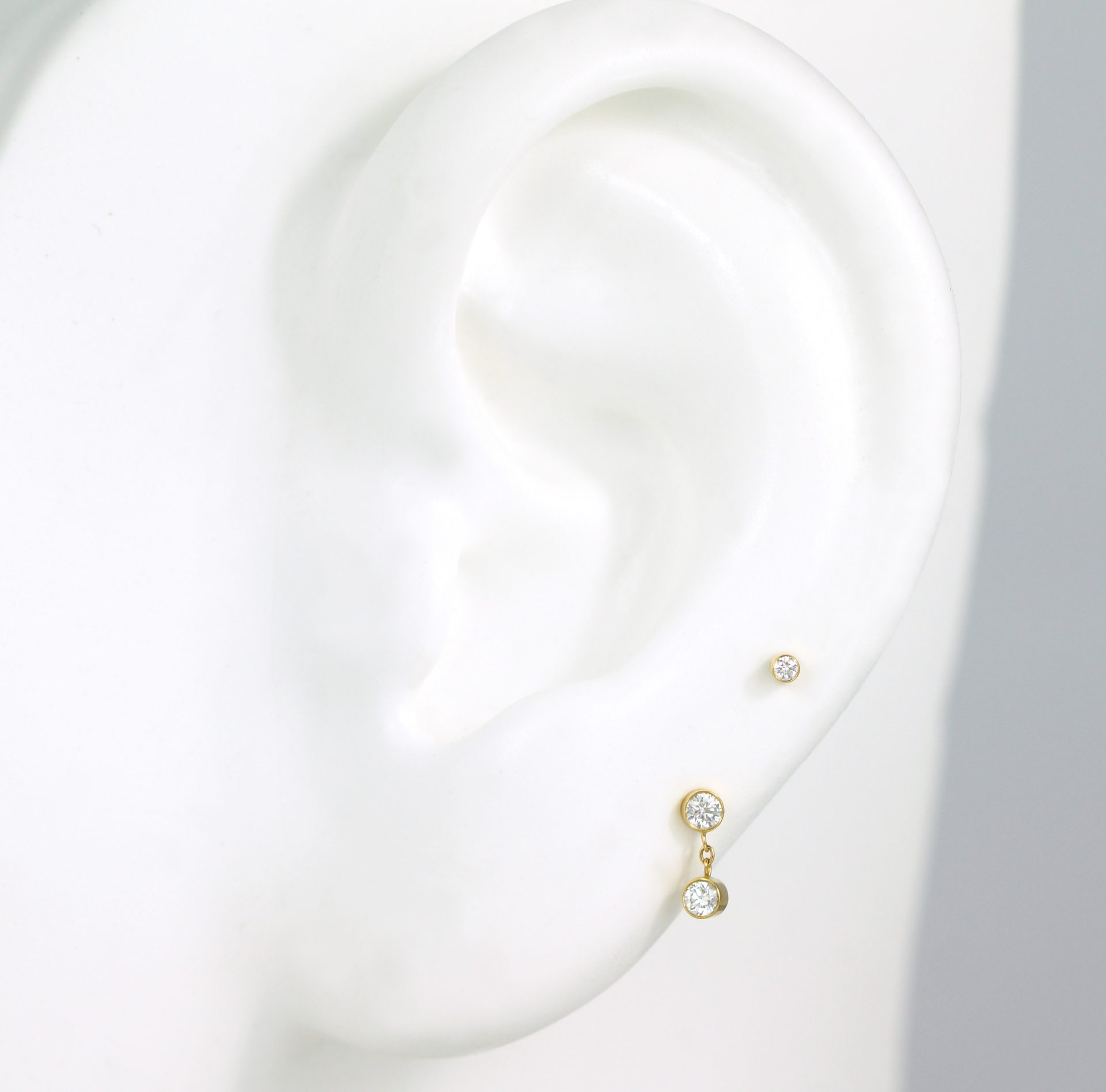 Multi-buy Option. You can get this set of luxury piercing earrings for a better price. Save £ on these 18k gold diamond cartilage studs!