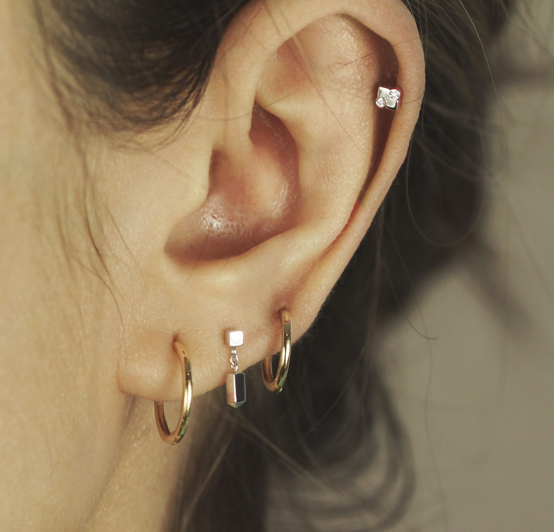 What earrings are proving the most popular? jewellery depicts the modern day cube with an abstract diamond eye
