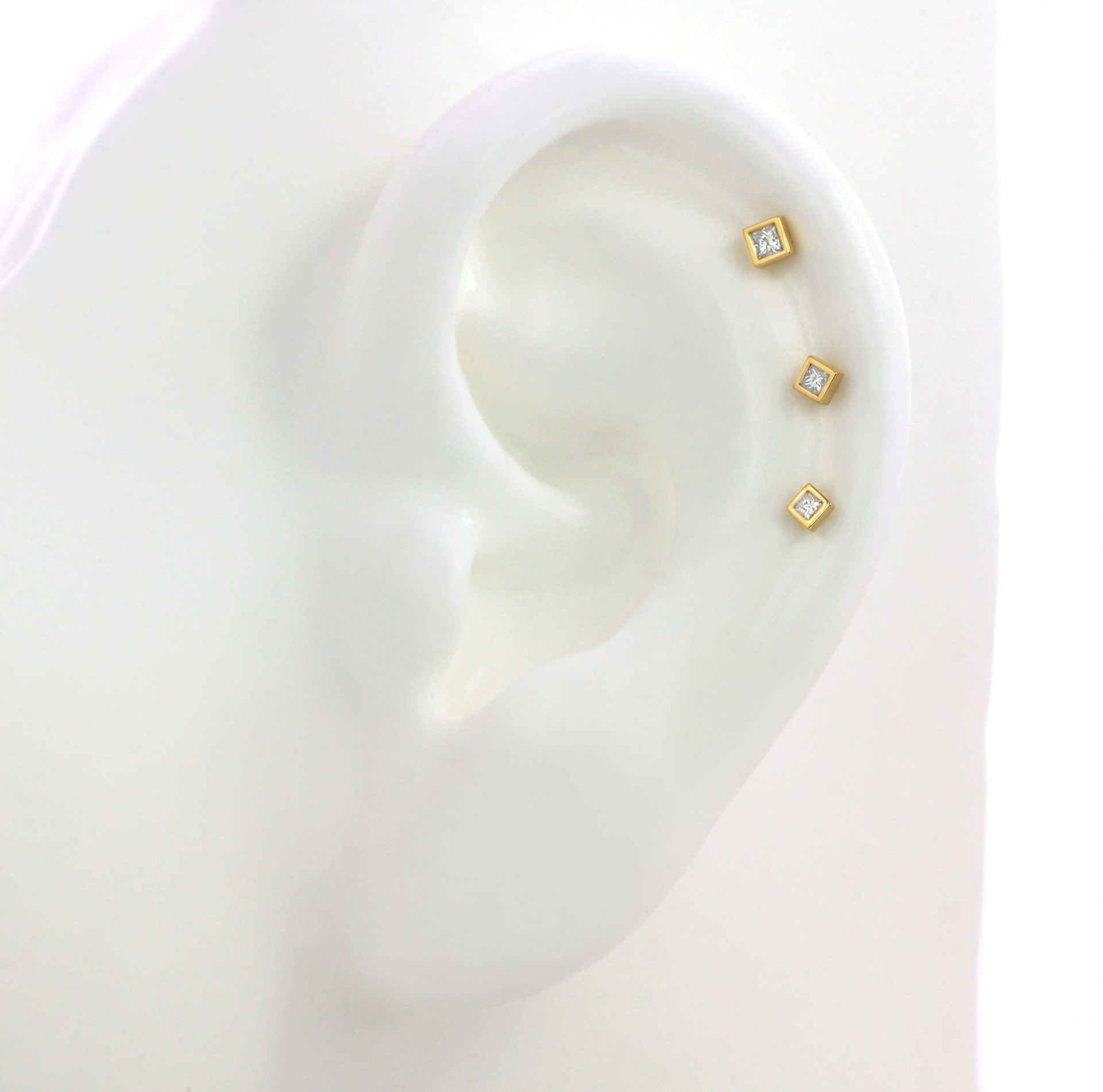 square-shaped-helix-cartilage-earring-luxury-piercing-lena-cohen-british-designer