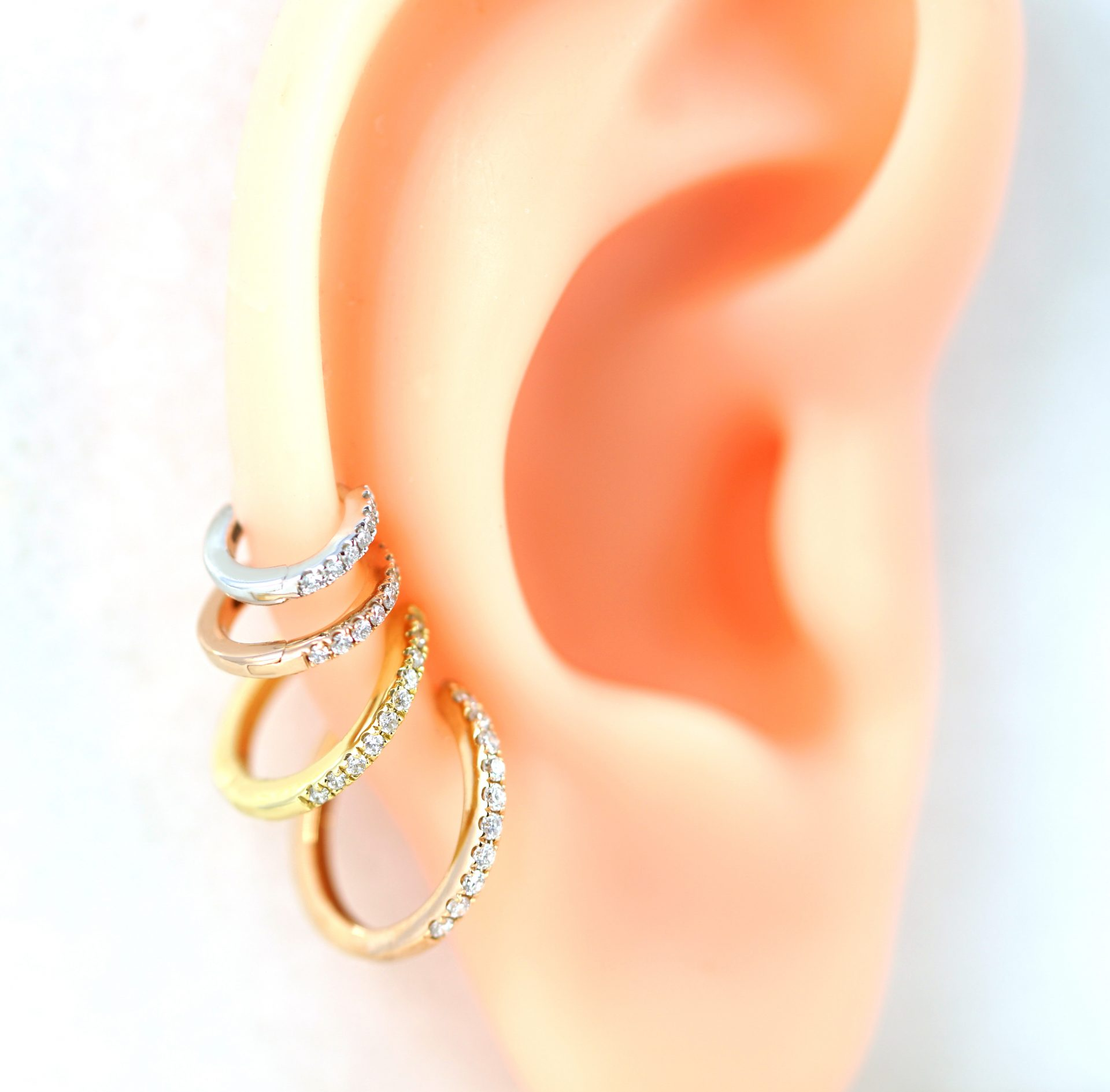 lena-cohen-luxury-piercing-london-18k-yellow-white-rose-gold-diamond-huggie-hoops-tragus-helix-lobe-earring