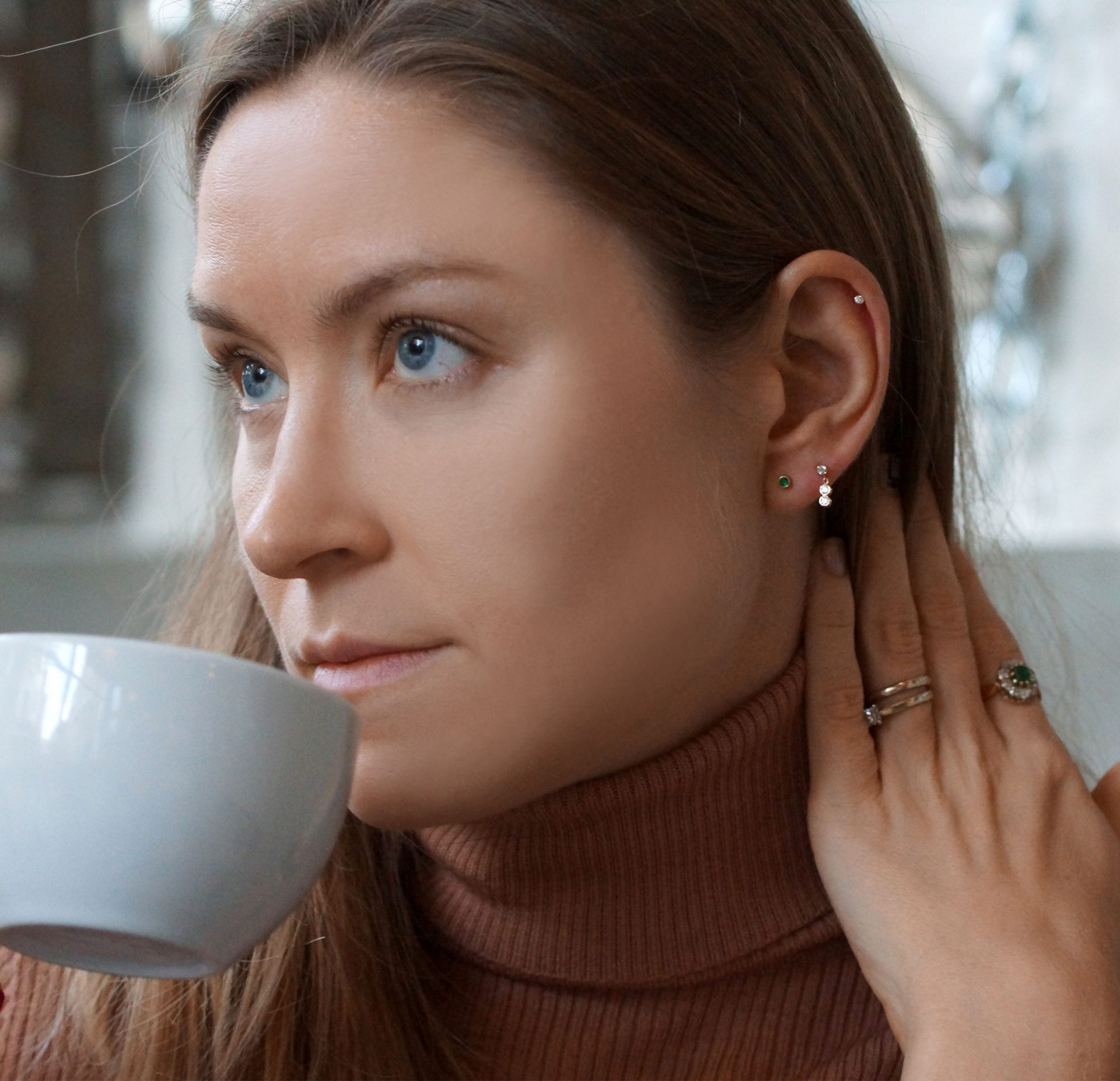 high neck sweater it's nearly impossible to wear a necklace The perfect pieces of jewelry to wear with this type of sweater is a pair of multiple piercing earrings combination from luxury british brand Lena Cohen
